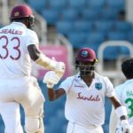 Jayden Seales (L) and Kemar Roach (2L) of West Indies celebrate winning on day 4 of the 1st Test between West Indies and Pakistan at Sabina Park, Kingston, Jamaica, on August 15, 2021. (Photo by Randy Brooks / AFP) (Photo by RANDY BROOKS/AFP via Getty Images)