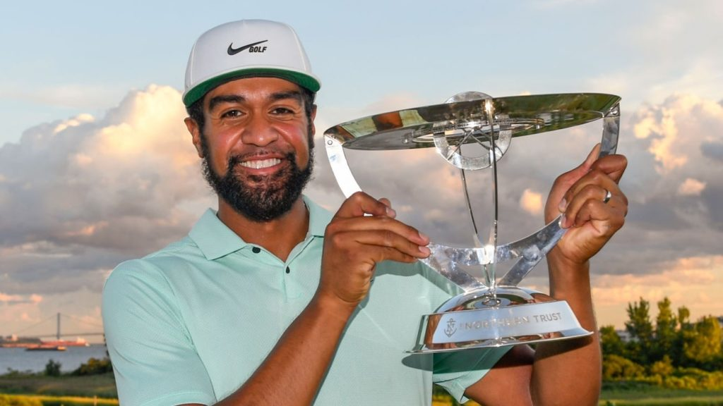 JERSEY CITY, NJ - AUGUST 23: Tony Finau poses with the trophy after winning in a playoff during the weather delayed final round of THE NORTHERN TRUST at Liberty National Golf Club on August 23, 2021 in Jersey City, New Jersey. (Photo by Tracy Wilcox/PGA TOUR via Getty Images)