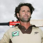 AUCKLAND, NEW ZEALAND - FEBRUARY 14: Chris Cairns of the New Zealand cricket team wearing a retro style outfit at Eden Park February 14, 2006 in Auckland, New Zealand. New Zealand play a 20/20 match against the West Indies at Eden Park on Thursday wearing the beige colours, which will double as Chris Cairn's final appearance for New Zealand. (Photo by Phil Walter/Getty Images)