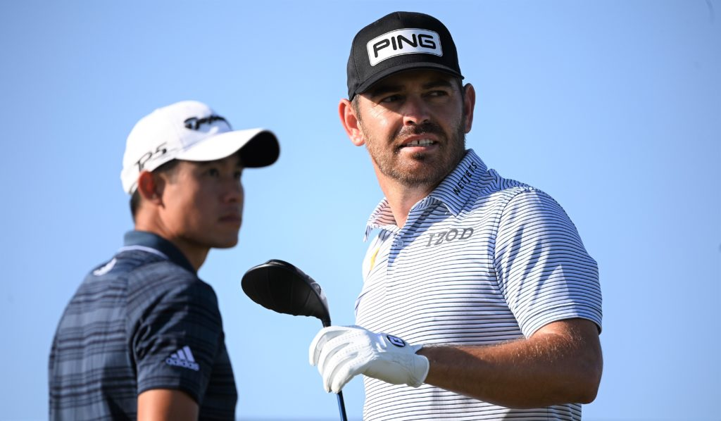 epa09351101 Louis Oosthuizen of South Africa (R) and Collin Morikawa of the U.S. (L) before teeing off on the ninth tee during the 3rd round of The Open 2021 golf championship at Royal St George's golf course in Sandwich, Kent, Britain, 17 July 2021. EPA/NEIL HALL