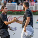 epa09448296 Patrick Cantlay (L) of the USA greets Jon Rahm (R) of Spain after finishing on the eighteenth hole during the third round of the 2021 TOUR Championship golf tournament at the East Lake Golf Club in Atlanta, Georgia, USA, 04 September 2021. The tournament is the finale of the PGA Tour FedExCup playoffs. EPA/ERIK S. LESSER