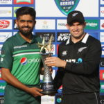 epa09471453 Pakistan's captain Babar Azam (L) and his counterpart Tom Latham (R) of New Zealand pose with the Winners Pakistan vs New Zealand ODI series 2021 trophy during a press conference at the Cricket Stadium in Rawalpindi, Pakistan, 16 September 2021. The New Zealand cricket squad arrived in Pakistan for their first tour in 18 years to play 3 ODIs in Rawalpindi and 5 T20s in Lahore. EPA/SOHAIL SHAHZAD
