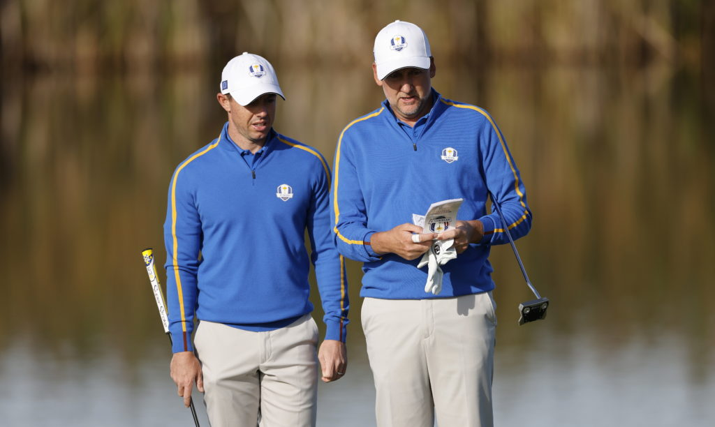 epa09485912 The Europe Team's Rory McIlroy of Northern Ireland (L) and Ian Poulter of England (R) on the fifth hole during the Foursomes matches on the first day of the pandemic-delayed 2020 Ryder Cup golf tournament at the Whistling Straits golf course in Kohler, Wisconsin, USA, 24 September 2021. Competition for the 43rd Ryder Cup between the US and Europe begins 24 September 2021. EPA/ERIK S. LESSER
