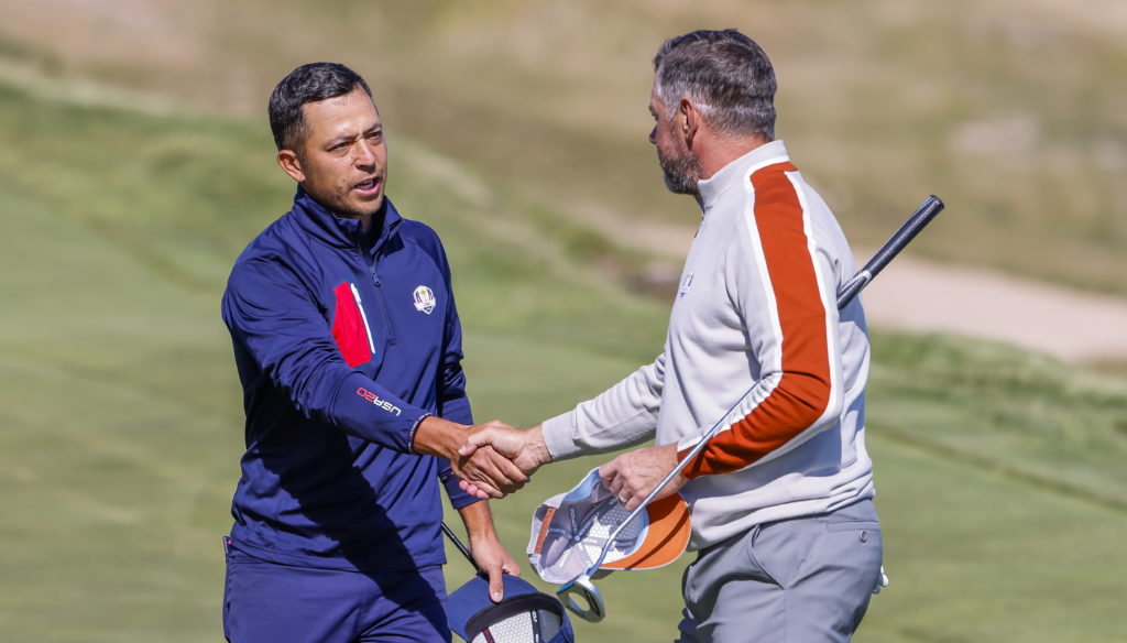 epa09488002 US team member Xander Schauffele (L) shakes hands with European team member Lee Westwood (R) of England after the US team of Schauffele and Patrick Cantlay defeated the European team of Westwood and Matt Fitzpatrick at the seventeenth hole during a foursomes match in the pandemic-delayed 2020 Ryder Cup golf tournament at the Whistling Straits golf course in Kohler, Wisconsin, USA, 25 September 2021. EPA/ERIK S. LESSER