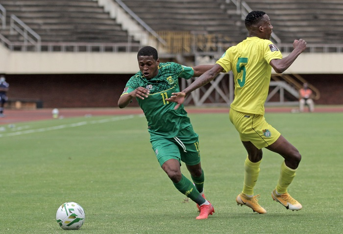 Luther Singh of South Africa goes past Divine Lunga of Zimbabwe during the Qatar 2022 FIFA World Cup qualifier between Zimbabwe and South Africa