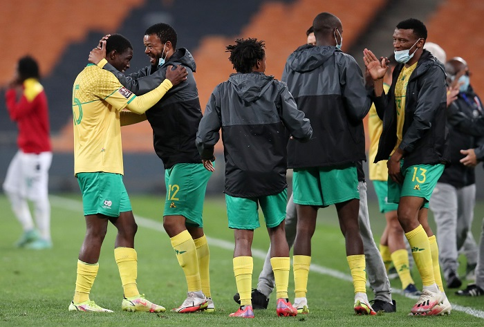 Sipho Mbule celebrates victory with Bongokuhle Hlongwane of Bafana Bafana during the 2022 World Cup Qualifier match between South Africa and Ghana