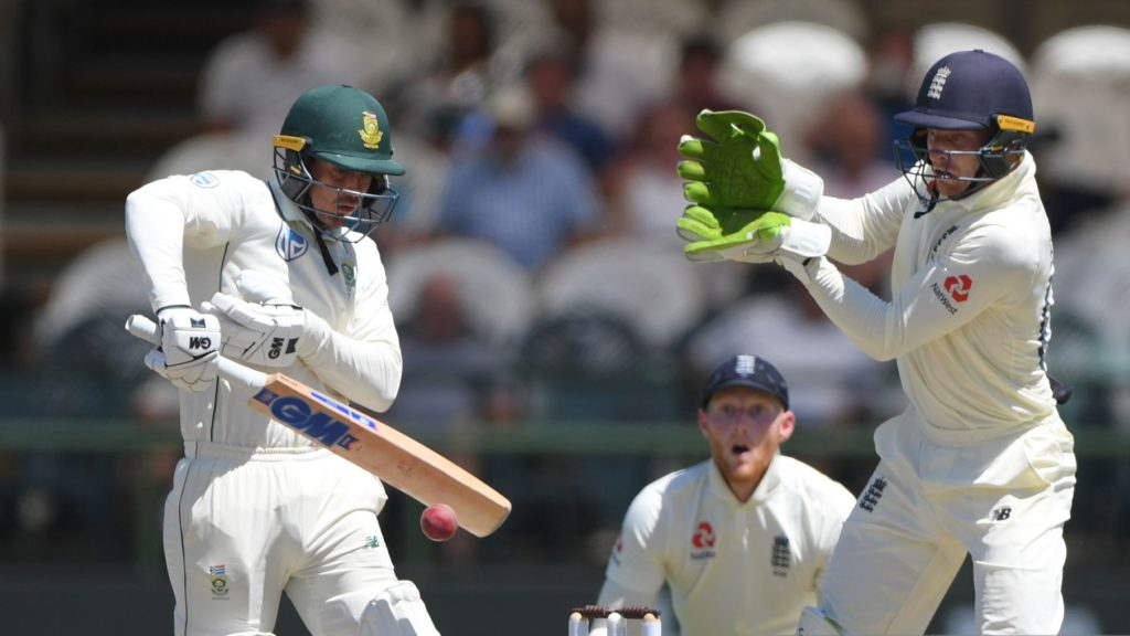 CAPE TOWN, SOUTH AFRICA - JANUARY 07: South Africa batsman Quinton de Kock plays a defensive shot off the bowling of Joe Denly as Ben Stokes and Jos Buttler react during Day Five of the Second Test between South Africa and England at Newlands on January 07, 2020 in Cape Town, South Africa. (Photo by Stu Forster/Getty Images)