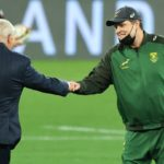 CAPE TOWN, SOUTH AFRICA - JULY 14: South Africa coach Rassie Erasmus (r) greets Warren Gatland before the match between South Africa A and the British and Irish Lions at Cape Town Stadium on July 14, 2021 in Cape Town, South Africa. (Photo by David Rogers/Getty Images)