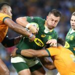 BRISBANE, AUSTRALIA - SEPTEMBER 18: Handre Pollard of South Africa is tackled during The Rugby Championship match between the Australian Wallabies and the South Africa Springboks at Suncorp Stadium on September 18, 2021 in Brisbane, Australia. (Photo by Jono Searle/Getty Images)
