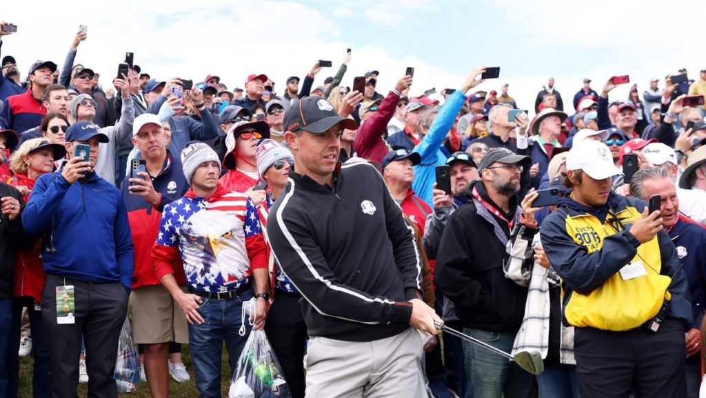 KOHLER, WISCONSIN - SEPTEMBER 23: Rory McIlroy of Northern Ireland and team Europe plays his shot as fans look on during practice rounds prior to the 43rd Ryder Cup at Whistling Straits on September 23, 2021 in Kohler, Wisconsin. (Photo by Warren Little/Getty Images)