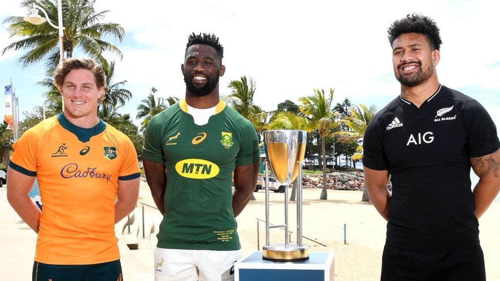 TOWNSVILLE, AUSTRALIA - SEPTEMBER 24: Michael Hooper of the Wallabies, Siya Kolisi of the Springboks and Ardie Savea of the All Blacks pose with the Rugby Championship trophy during a media opportunity ahead of this weekend's Rugby Championship matches at Strand Park on September 24, 2021 in Townsville, Australia. (Photo by Ian Hitchcock/Getty Images)