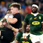TOWNSVILLE, AUSTRALIA - SEPTEMBER 25: Jordie Barrett of the All Blacks is tackled during the Rugby Championship match between the New Zealand All Blacks and the South African Springboks at QCB Stadium on September 25, 2021 in Townsville, Australia. (Photo by Chris Hyde/Getty Images)