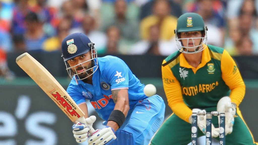 MELBOURNE, AUSTRALIA - FEBRUARY 22: Virat Kohli of India bats as wicketkeeper Quinton de Kock of South Africa looks on during the 2015 ICC Cricket World Cup match between South Africa and India at Melbourne Cricket Ground on February 22, 2015 in Melbourne, Australia. (Photo by Scott Barbour/Getty Images)