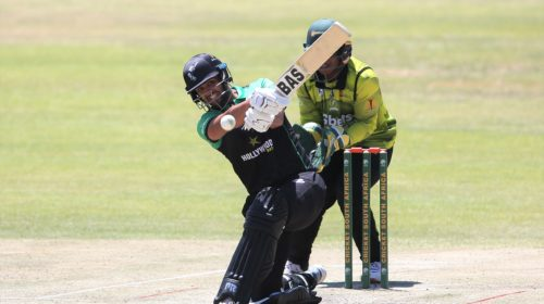 Jason Smith of Hollywoodbets Dolphins hits over the top for six during the 2021/22 CSA Provincial T20 Cup quarter-final match between the Hollywoodbets Dolphins and Gbets Warriors held at the Diamond Oval in Kimberley on 20 October 2021 ©Shaun Roy/BackpagePix