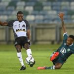 Lehlohonolo Majoro of Amazulu try's to defend an attack from Arsene Zola Kiaku of TP Mazembe FC