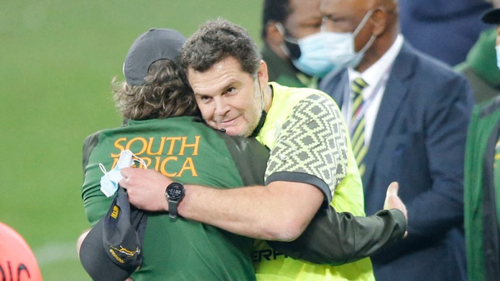 South African Director of Rugby Rassie Erasmus (2nd L) is congratulated at the end of the second rugby union Test match between South Africa and the British and Irish Lions at The Cape Town Stadium in Cape Town on July 31, 2021. (Photo by PHILL MAGAKOE / AFP) (Photo by PHILL MAGAKOE/AFP via Getty Images)