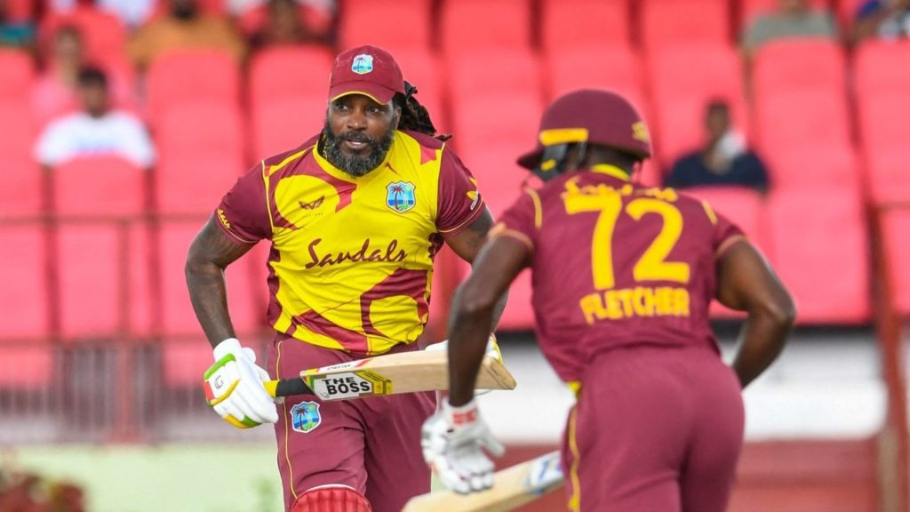 Chris Gayle (L) of West Indies runs during the 3rd T20I match between West Indies and Pakistan at Guyana National Stadium in Providence, Guyana on August 1, 2021. (Photo by Randy Brooks / AFP) (Photo by RANDY BROOKS/AFP via Getty Images)